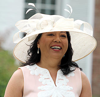 Leizel Miles is all smiles as she shows off a this hat and dress combo.