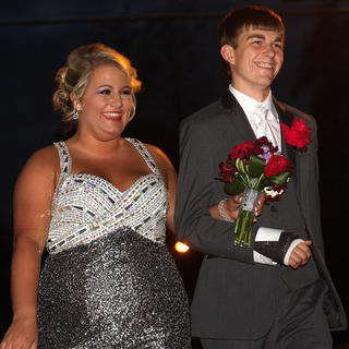 Paige Wilcher and Dalton Rucker smile at the crowd as they walk into Centre Square.