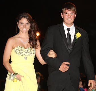 Kaitlyn Miles and Trevor Mattingly smile at the many flashing cameras as they walk into Centre Square.