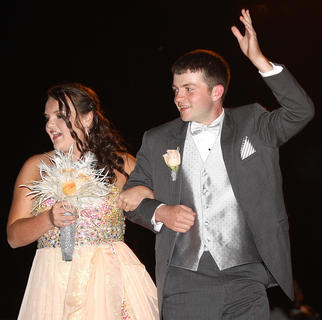 Joe Ben Curtis waves to his adoring fans as he and his (a Taylor County student) walk into prom.