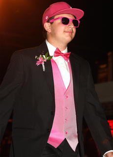 Logan Medley shows that real men wear pink at prom.