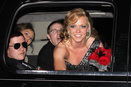 Colleen Rakes smiles at the crowd as she prepares to open the limo door and make her grand entrance into prom. Also pictured are Justin Mattingly, Danielle Carrico and Aaron Spalding.