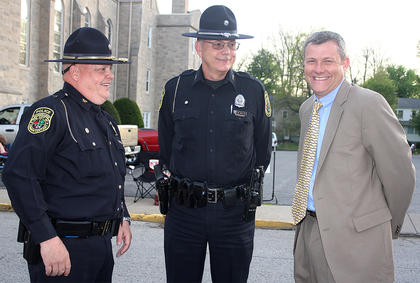 "Lebanon Police Chief Wally Brady and School Resource Officer William ""Bill"" Walsh talk with Marion County High School Principal Mike Abell before the prom festivities begin."