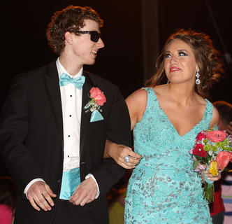 Stephen Shewmaker and Paige Buckman share a smile as they make their grand entrance into prom.