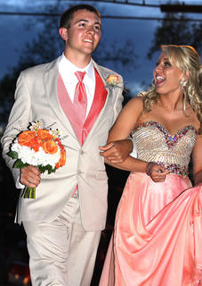 Cody Thomas graciously holds Katlin Masterson's flowers as they walk into Centre Square.