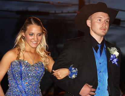 Breanna Walls and her cowboy date arrive at prom.
