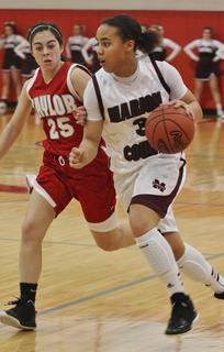 Makayla Epps drives by her defender in the Lady Knights opening round win in the 20th district tournament.
