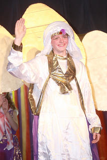 Aladdin (Luke Jones) arrives at the sultan's palace in disguise as Prince Ali Ababwa.