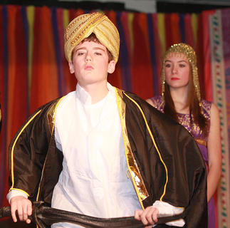 Prince Dahdu Rahn-Rahn (Nicholas O'Daniel) attempts to impress the princess with a display of swordsmanship.