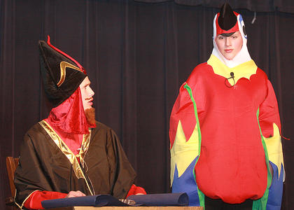 Jafar (Isaac Lanham), the sultan's advisor, discusses his plan with his parrot, Iago (Brett Gordon).