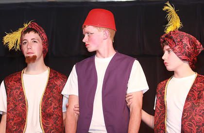 Aladdin (Luke Jones) is taken captive by the sultan's guards (Evan Brady, left, and Nicholas O'Daniel).