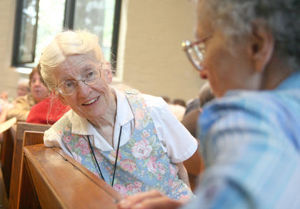 Sr. Mary Swain listens as fellow member of the Loretto Community discusses issues the community plans to pursue in the future.