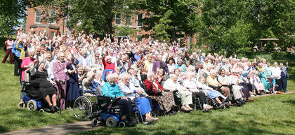 Hundreds of members of the Loretto Community wave after taking a photo at the Motherhouse to commemorate the order's 200th anniversary.