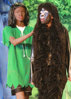 "St. Augustine's eight graders performed The Jungle Book Kids on April 24. The story follows Mowgli, a human, as Bagheera the panther and Baloo the bear try to keep him safe from harm, especially from the tiger Shere Khan. Mowgli (Madelyn Hagan) follows Bagheera (Jennifer Castillo) through the jungle. Bagheera plans to return Mowgli to the ""man village"", something Mowgli doesn't want to do."