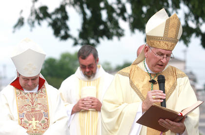 Rev. Joseph Kurtz (right), the archbishop of Louisville, offers a prayer of blessing Sunday over the memorial to the Ursuline Sisters in front of the David R. Hourigan Government Building. Rev. William Medley (left), the bishop of Owensboro, and Deacon Dennis May are in the background.