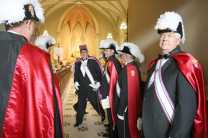 The Knights of Columbus were dressed for the special Mass Sunday at St. Augustine in honor of the Ursuline Sisters of Mt. St. Joseph.