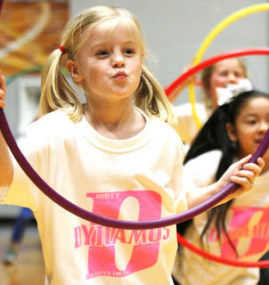 Hadley Potter strikes a pose with her hula hoop.