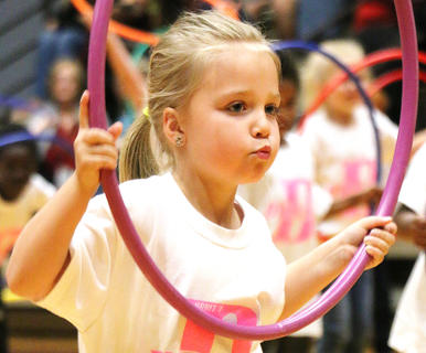 Eleanor Stewart strikes a pose with her hula hoop.
