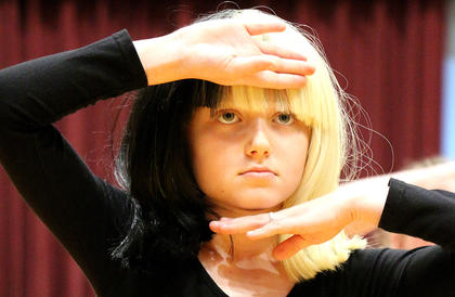 Vanessa VanWhy channels the musician Sia during her performance.