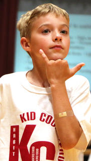 Logan Tate does sign language during the GES Showcase.