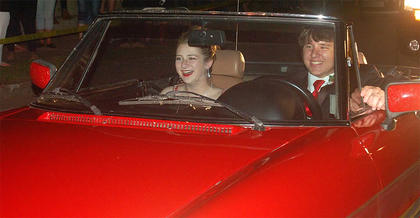 Pictured are Olivia Gaddie and Sam Smith arriving to prom in style.