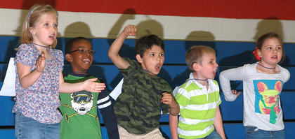 Kindergartners Melinda Hooiser, Jamarion Calhoun, Samuel Cruz, Aiden Forbes and Avery Newton cheer on the classmates.