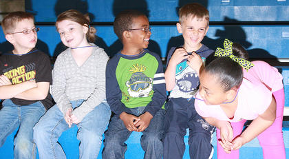 Kindergartners Ryan Hersker, Arora Norris, Jamarion Calhoun, Jaxon Huff and Aleea Sickles wait for the races to begin.