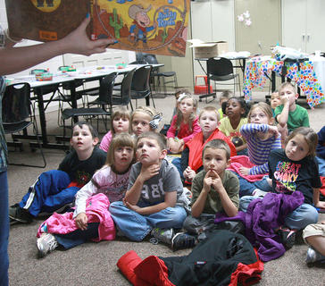 "Tammy Durham's kindergarten class listen to Children's Librarian Patty May Brown read ""Are You a Horse?"" by Andy Rash to."