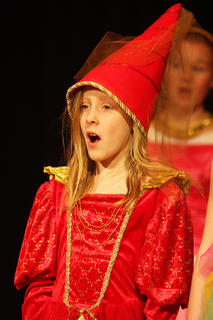 Graci Wilson, a royal subject, sings during a recent dress rehearsal.
