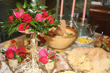 Beautiful roses adorn the table full of food, which featured homemade ham biscuits and Mexican Burgoo.