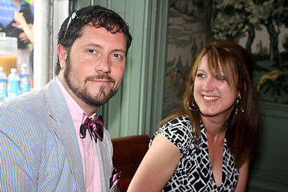 Lee Guilfoil flashes a fashionable grin in his festive pink and navy bowtie. Also pictured is Katherine Kirzinger.