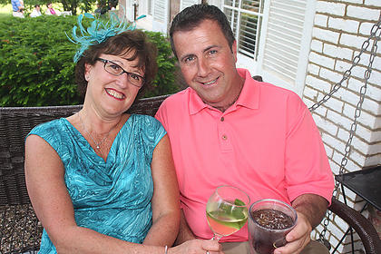 Pam Bell Blakemore and Scott Browning enjoy some cold beverages on a porch swing at Myrtledene Bed and Breakfast.