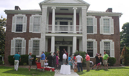 Party goers gather on the front lawn at Myrtledene Bed and Breakfast.