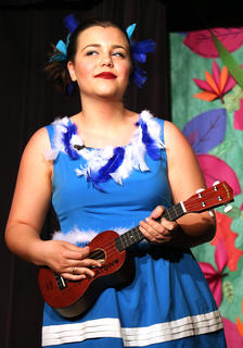 Avery Ward, playing the part of Gertrude the bird, sings about her one feather tail.