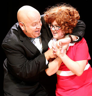 """Van Gadberry, playing the part of Oliver """"Daddy"""" Warbucks, and Brooklyn Richardson, playing the part of Annie, sing and dance together."""