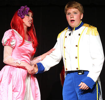 Prince Eric, played by Zachary Mullins, is shocked as he discovers that Ariel, played by Jessica Thomas, has her voice back and has an amazing singing voice.