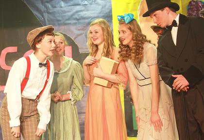 Winthrop Paroo (Kaylee Thomas) sings his excitement about the possibility that the Wells Fargo wagon may be bringing his cornet. Behind Winthrop, from left, are his mother (Haley Ruley), his sister Marion Paroo (Jane Palagi), the mayor's daughter  (Cassandra Thomas) and Mayor Shinn (Kelly Mattingly).