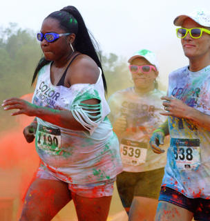 Some runners had no trouble staying focused as they ran through the final color stop.
