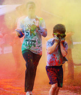 By the final color stop, runners had developed their own strategies for dealing with the colored powder.