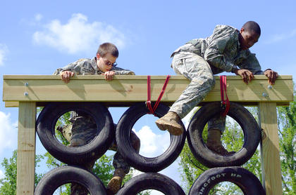 Vincent Pigati, left, and Shaquille Keene reach the top of the tire climb.