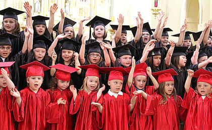 St. Augustine's preschoolers perform a special song before accepting their diplomas.
