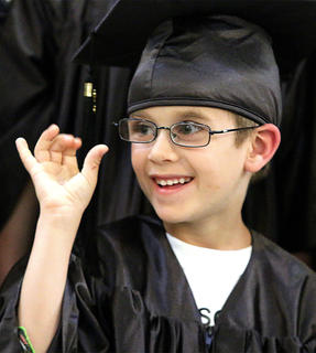 Rucker Filiatreau waves to his parents during the graduation ceremony.