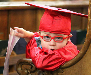 Carter Pruitt it stylin' in his bright red glasses and red cap and gown.