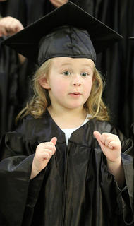 Ava Bright sings a special song at the end of the graduation ceremony.