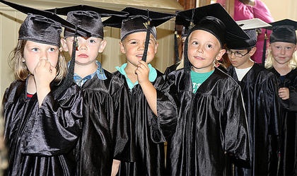 Ella Raley, Grayson Myers, Thomas Moore, Chase Luckett, Rucker Filiatreau and Mary Claire Rakes wait patiently for the graduation ceremony to begin.