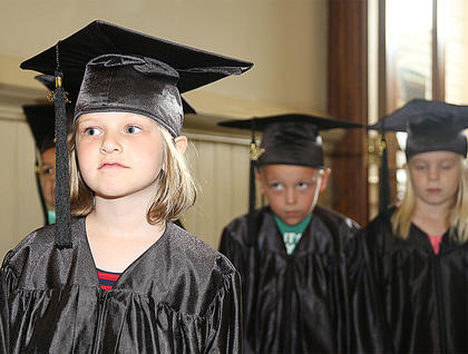 Ella Raley looks anxiously inside the church sanctuary as she waits for the graduation ceremony to begin. Also pictured are Chase Luckett and Hadley Potter.