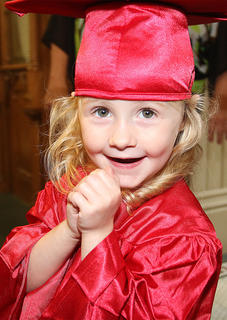 Madison Sizemore flashes a big smile as the graduation ceremony begins.