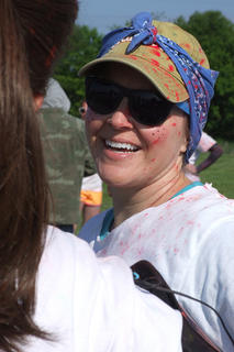Wendy Smith keeps smiling while chatting with another runner after finishing the Color in Motion 5K.