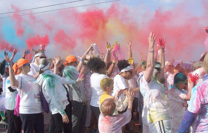 Before the run begins, participants throw colored corn starch in the air.