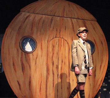"Ally Howard plays the part of James during a matinee performance of ""James and the Giant Peach"" Saturday afternoon. James is a seven-year-old orphaned boy who is forced into the care of his repulsive and abusive aunts, Spiker and Sponge, after his parents are killed by a rhinoceros."